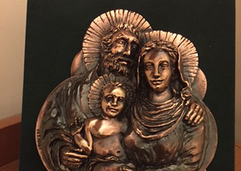 Here's one of the commemorative gifts we were given – a rather lovely image in metal of the Holy Family.
