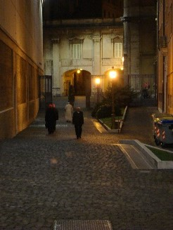 A content Pope Francis walks home